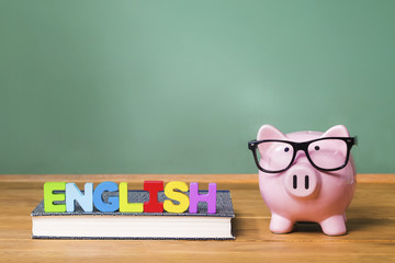 English language theme with pink piggy bank with chalkboard