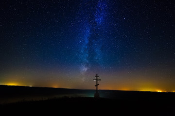 Temple in the night sky and the Milky Way, the silhouette of the church on the background of the Milky Way
