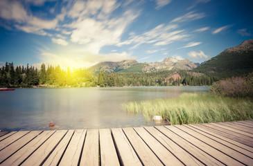 Alpine mountain lake at sunny day