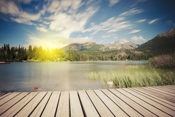 Alpine mountain lake at sunny day