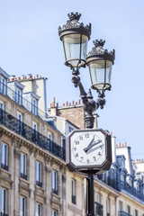 PARIS, FRANCE, on AUGUST 26, 2015. A fragment of a typical facade in historical part of the city. Old streetlight.
