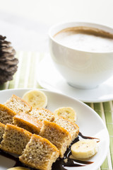 bananas cake with hot coffee , focus at banan cake