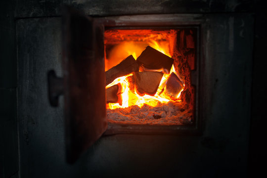 closeup of  wood stove with the burning firewood.