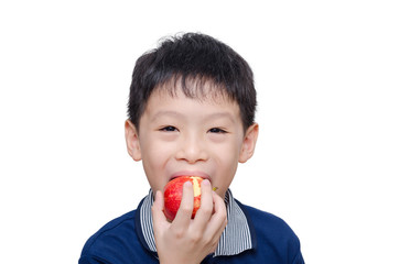 Asian boy eating an apple over white background