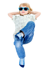 Young little boy to lying on the floor with blue sunglasses in jeans and shirt, Isolated on white background, Positive human emotion, facial expression