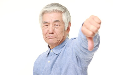 senior Japanese man with thumbs down gesture