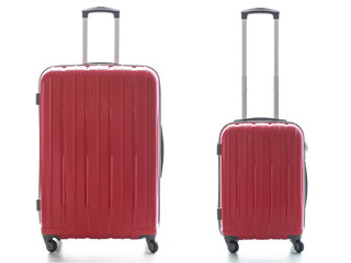 This photo is a still life about two red suitcase rigid.