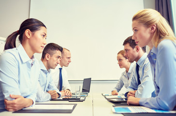smiling business people having conflict in office