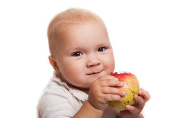 baby with an apple  on a white background