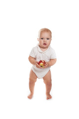 baby  walking with an apple  on a white background