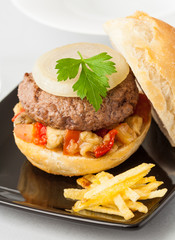 Pljeskavica, a hamburger with vegetables typical from Serbia