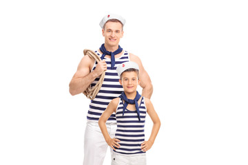 Young man and a kid in sailor outfits