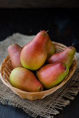 organic pears in the plate, on the wooden background