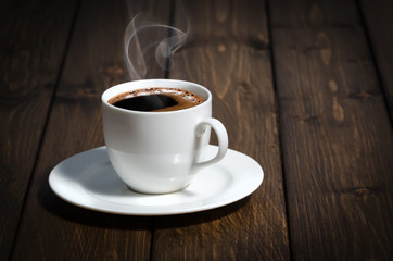 Coffee cup on the wooden table.