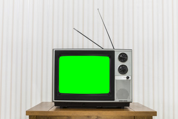 Old Television On Wood Table With Chroma Key Green Screen