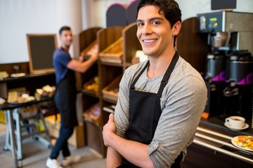 Handsome waiters smiling at camera