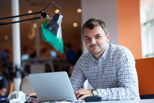 startup business, software developer working on computer