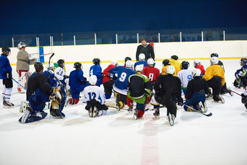 ice hockey players team meeting with trainer