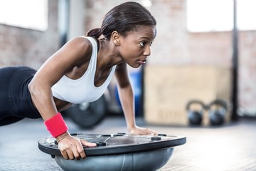 Muscular woman doing fitness workout