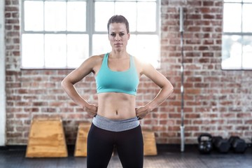 Fit woman posing with hands on hips