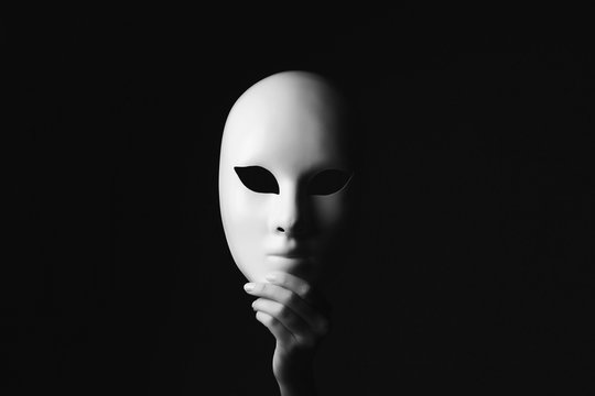mask in hand.halloween