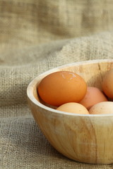 Eggs wooden bowl hessian.