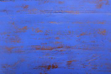 Dark blue rustic wood background.