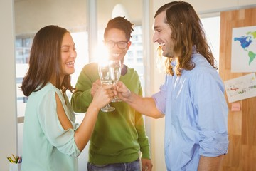 Business people toasting during celebration in creative office