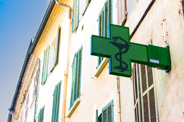 city ​​panels pharmacy cross in the alps