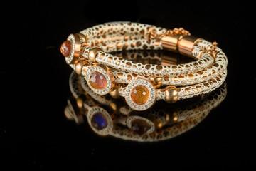 jewelry and bracelets on a black background
