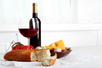 Set of products with wine bottle on light background