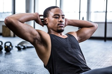 Fit man working out in studio