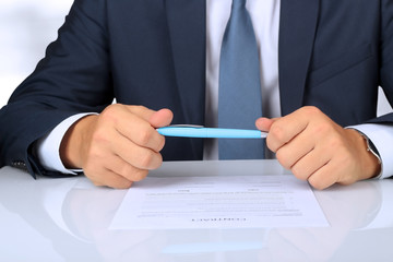 Businessman is doubting  about signing  a contract, business con