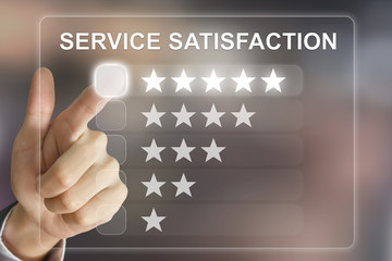 business hand pushing service satisfaction on virtual screen