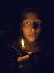 Teen girl with a candle