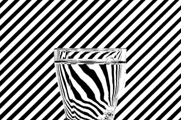 Abstract refraction of black and white diagonals in a glass of w