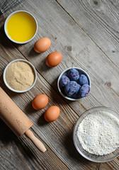 Baking cake in rural kitchen - dough recipe ingredients (eggs, f