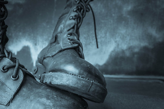 Combat boot on wooden