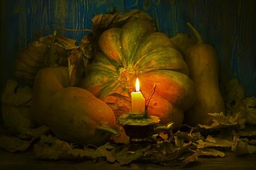 Pumpkins lit candle