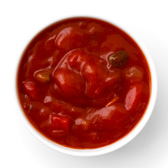 Round white bowl of tortilla tomato salsa dip isolated from abov