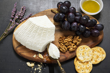 appetizer with ricotta. lavender, grapes, walnuts, olive oil and