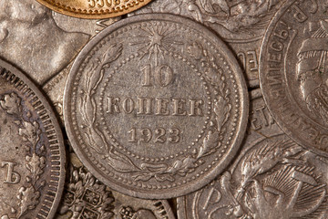 Old coins. Ten cents. Russian coins of the last century . Silver . Workers of the world unite!