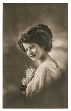 Vintage portrait of young woman with flowers. Retro picture