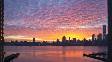 Colorful dreamy sunrise panorama of Manhattan from New Jersey side in New York City