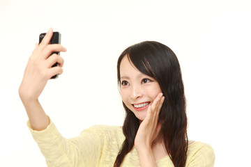 Japanese woman takes a selfie