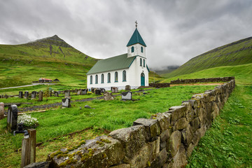 Small village church with cemetery in Gjogv, Faroe Islands, Denm