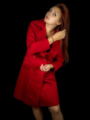 Studio photo of a pretty young woman in red coat