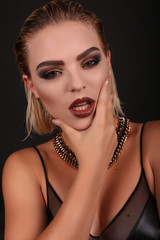 sexy girl with blond hair and evening makeup,looks like rock star