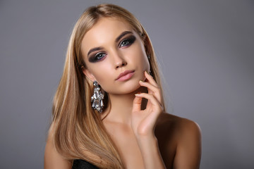 beautiful girl with blond hair and evening makeup with bijou