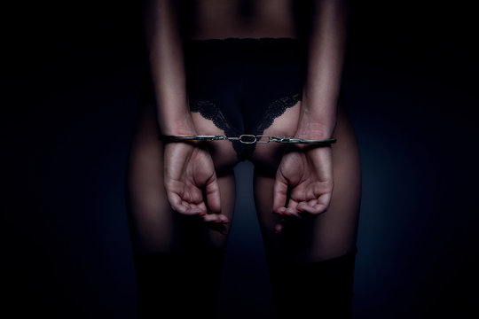 attractive girl back and hand with handcuffs